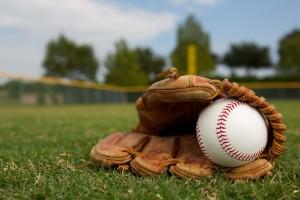 Baseball glove sitting on a field